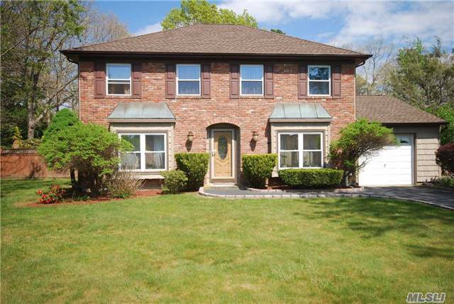 Traditional Brick Front Colonial In N. Coram, Boasting 8 Spacious Rms, 4 Br's, 2.5 Baths. Offers Cac, Fireplace, Garage, Alarm. Updates Inc. Kitchen W/Ss Appliances, 30 Yr Roof, Siding, Windows. Beautiful Park-Like Grounds Surrounded By Gorgeous Mature Specimen Plantings, Fully Fenced W/Deck, 2 Sheds & Igs. Ug Utilities, Sewers & Quick Access To Port Jeff Village & Ferry.