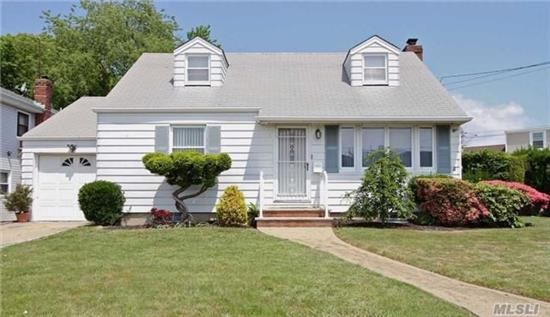 Charming Cape In Seaford School District. House Is Freshly Painted- New Carpets In Basement And Upstairs Bedrooms. Wood Floors. 2 Year Old Boiler, Newer Windows. Fenced Property. Gas Lines In Street- No Charge To Run To House! Great Neighborhood! Must Reapply For Star