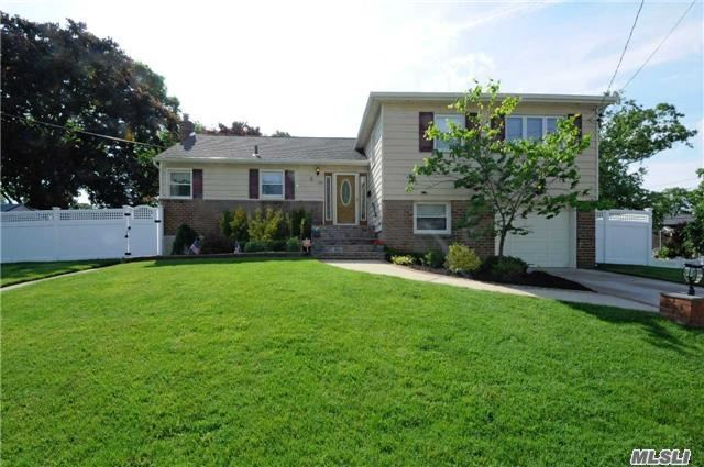 Beautiful 4 Br 3 Bth Split In Sd#23 Updates Include: Windows, Kitchen, Baths, Gorgeous Hardwood Floors, 200 Amp Electric, Gas Heat, Separate Hw Heater, Family Rm. + Full Basement. Professional Landscaped. Never-Ending House, Room For Extended Family Or Room For Mom With Proper Permits.