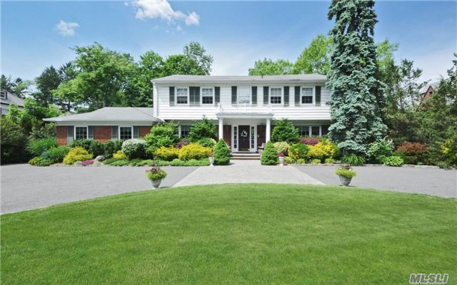 Diamond Center Hall Colonial W/ 5 Bed, 3.5 Bath W/ Over 3, 600 Interior Sq. Ft. This Spacious Home Has A Lg Master Suite W/ Wic, Updated Kitchen W/ Granite And Ss Appl. Family Suite On 1st Fl., Fp, Hw Floors,  Dual-Zone Central Air, New Multi-Zone Heating, Wine Cellar, 2 Car Garage, Updated 200 Amp. Electric, 9 Zn. Igs, Close To Lirr! Perfect For Large Families!