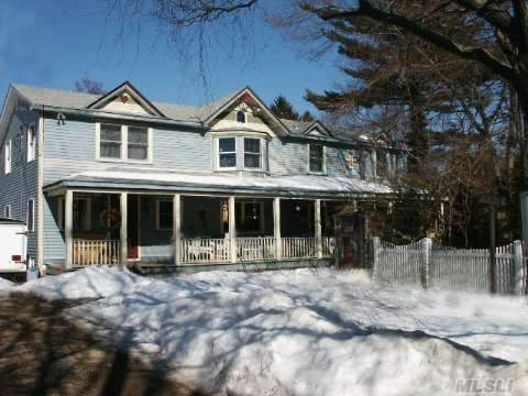 Waiting For Your Creative Touch....5 Bedroom, Secluded Home With 55 Foot Front Porch, New Windows, New Plumbing, New Electric And New Insulation. Custom Moldings And Custom Built-In's.  Walking Distance To Elementary School, Parks And Beaches. Kitchen Renovation Started, Needs To Be Completed.