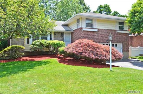 Move Right In!! Beautiful Split Level Home W/ 3 Br's & 2 Full Baths, Lr, Fdr W/ Sliders To Deck, Eat-In-Kitchen W/ Gas Cooking, Family Room, Master Br En Suite, Beautiful Hardwood Floors, 2 Car Garage, Great Mid-Block Location. A Must See!