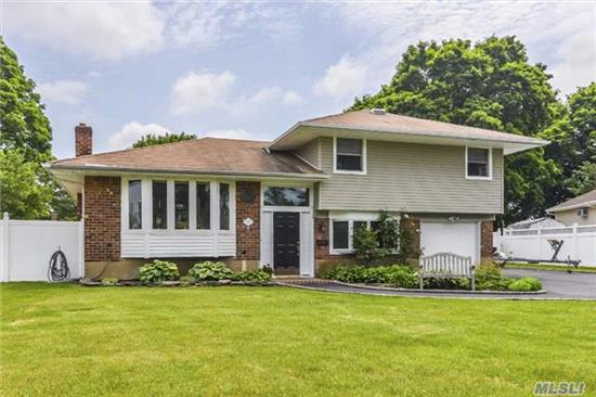 Move Right In To This Beautifully Updated And Expanded Split. Open Floor Plan, Hardwood Floors Thruout, New Cac, .Enjoy Entertaining In This Beautiful Lanscaped Yard. L Shaped In Ground Pool, With Huge Separate Cabana . Plenty Of Room For Extended Family.