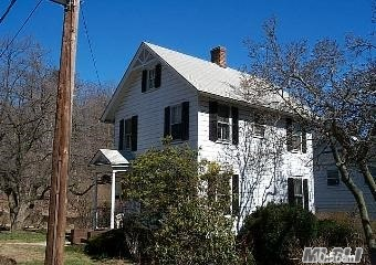 Charming 4 Bedroom Colonial In The Historic Village Of Roslyn. This Beautiful Home Needs T.L.C. New Roof.