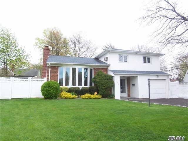 Situated In The Middle Of This Cull-De-Sac Lies This Very Spacious Split Level Featuring : Updated Siding, Windows, Roof, Heat System, Updated Full Bath, Wood Floors, Brick Wall Fireplace, Cac, Finished Basement, New Double Driveway With Belgium Block, Florida Room.Pvc Fencing, Alarm System