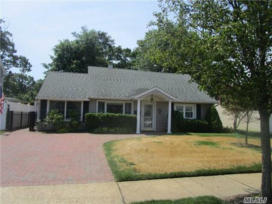Wantagh Woods Mint Expanded Cape. 1925 Sq Ft Of Living Space. 20X25' Vaulted Family Room. Open Layout. Updated Kitchen, Windows, Siding, Roof. Gorgeous Hardwood Floors. Beautiful Park Like Property With Pond. House Is Expanded And Back Dormered. Mid Block Location. Close To Beech St Elementary. Taxes Are Without Star. Move Right In..Great House