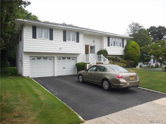 Land Spreading Out So Far And Wide .... Expanded Hi-Ranch On Park Like Grounds. Lot Size 75*150. Eat In Kitchen With Sliders To Deck Over Den. Formal Dinning And Living Room. 4 Bedrooms, 2 Full Baths And Spacious Den With Sliders To Patio. Half Hollow Hills Schools. Near All Major Transportation. Boarder Of Nassau And Suffolk Counties