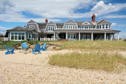 Brand new, another jewel from well respected architect Craig Arm. Set on over 1.5 acres directly on Moriches Bay in the heart of Remsenburg, this substantial +/- 8,500 sq. ft. 2 story custom residence shows the thought & care only achieved by years of experience in quality creation. With 580' of new bulkhead, a protected double boat slip, extensive south facing water-side covered porches, second floor balconies and pool side patios, this home sets the pace for true summer living. The 5 bedroom, 7 full-bath and 2 halfbath manse is move in ready. The volume and space is unmatched. Styled with the charm of shingle styled homes of the past, and the modern amenities for today's living, this brans new represents the best of both worlds. Some of the interior highlights: Living room with unobstructed water views, fireplace and built-ins; Formal and informal dining rooms; Waterside den; 1600 sq ft master suite with fireplace, private study, two baths and dressing rooms; Full paneled two-story foyer; Kitchen featuring top-of-the-line Subzero and Wolf appliances and exquisite custom cabinetry and hardware. Additional cabinetry in the living room, den, dressing rooms (and virtually every other room), with custom millwork and quality craftsmanship throughout. Add to that a unique 800 sq ft waterside entertainment/recreation pavilion with bath, laundry and unique telegraphing doors on three sides to bring the outdoors in, plus over 3000 sq ft of porches, balconies and patios, a custom 58' x 24' Roman edge Gunite swimming pool with integrated hot tub, full service exterior mahogany bar and professional landscaping. With oversized 3 car garage, Geothermal HVAC, Control-4 Automation, a back up generator, sandy wrap around beach with fire pit and prepared for expansion for 2 additional bedroom suites, this home is truly built for today's enjoyment and prepared for the future. A granular list of details of all amenities is available for qualified buyers. Open bay living doesn't get better than this.