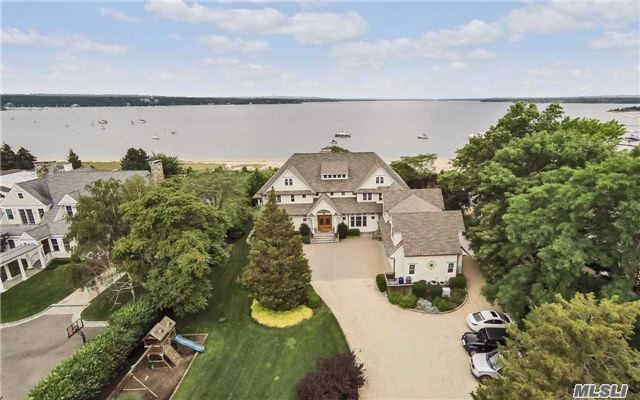 Once In A Lifetime Opportunity To See Direct Western Sunsets From This Spectacular 6400 Sq. Ft. Colonial With 100' Of Sandy Beach, Granite Kitchen, Brazilian Cherry Floors, Radiant Heat, Balcony From Bedrooms, Indoor And Outdoor Fireplaces, Gas Generator, Huge Crawl Space And Walk Up Attic, Gym, Sauna, Hot Tub. Way Too Much To List! A Must See!