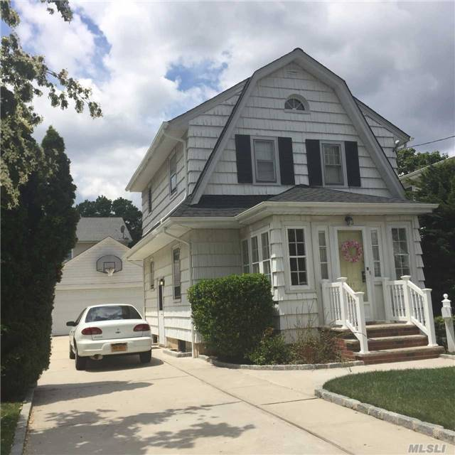 Location! Location! Location! Affordable Dutch Colonial On Great Block! 2/3 Br, Den On 1st Floor Could Be A Br/ Beautiful Hardwd Floors, Updated Electric And Heating. New Roof. New Driveway. New Garage Door. Charm Galore! Walk To Train And Stores. Make Offers!!