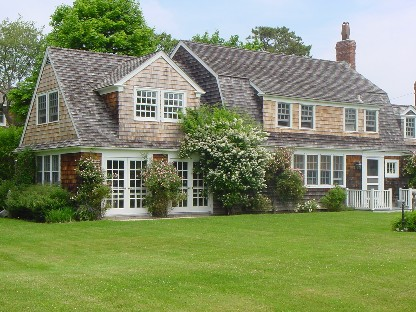Dating back to the late 1800's, and once part of the expansive Sandacre Estate, this home has withstood the test of time. The Gambrel style shingled cottage is full of original details but at the same time is updated for today's lifestyle. The warm and large country kitchen complete with fireplace is outfitted in modern high end appliances. A formal dining room, big enough to handle a huge crowd, overlooks the expansive grounds. The living room is lined with French doors and large windows bringing the outside in. The jewel of the property is a large renovated barn with exceptional original trims, period barn doors and natural woods. Inside there is wonderful space for entertaining, a huge shower room, separate bath and a fun second floor loft area large enough to sleep several guests. The very secluded grounds are improved with a gunite pool, herb garden and child's play house. This home has been meticulously maintained and is one of Quogue's most valued treasures.