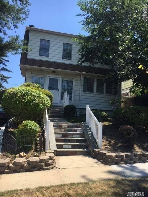 Lovely Single Family Colonial Home In Whitestone For Sale Features 4 Br, 1.5 Bath, Living Room, Formal Dr, Eat-In-Kitchen, Basement W/Laundry Room + Attic Space For Storage. Hardwood Flooring. Drwy + Garage + Yard. In District 25, All On A 40X100 Sq Ft Lot. Close To All!