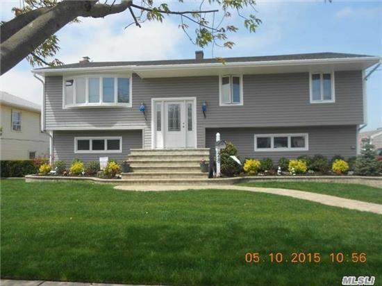 Magnificent Split Level Ranch On A Quite Dead End St. Beautiful 80Foot Dock 10 Houses From The Open Bay, Oversized Rooms Through Out The Home Must See Turn Key , Ready To Move In.