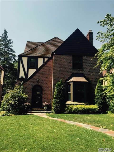 Brick Tudor With Large Eat-In Kitchen, 1/2 Bath Spacious Living Room With Entryway Into Formal Dinning Room. Second Floor Has Tree Bedrooms, One With En-Suite Bath And Second Full Bath. Full Attic With A Small Bedroom. Beautiful Backyard With A Patio