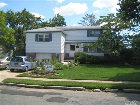 Super Split With Large Eik, 5 Bedrooms, Enclosed Sun Room, Deck, Patio. Possible Professional Office, New Burner, Convenient To All. Don't Miss It.