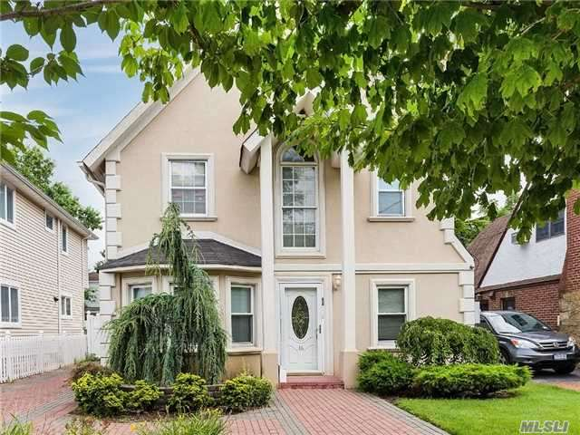 One Of A Kind Newly Re-Done Stucco Colonial With Wood Floors 3 New Baths, Skylights, New Windows.