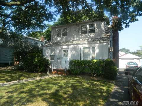 1 Family Cape With 3 Bedrooms, Living Room, Formal Dining Room, Eat In Kitchen, 1 Full Bath, Full Open Basement.  Newer Roof, 100 Amp Electric, Updated Windows, Gas Heat, Hardwood Floors, 1 Car Detached Garage With Private Driveway.  Near Tranportation, Shopping And Schools.