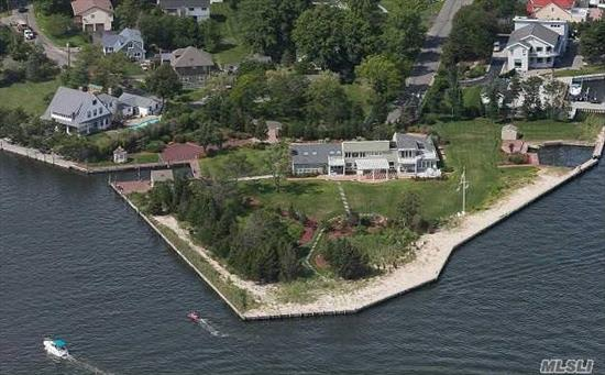 This Spectacular Bay Front Contemporary Is Situated 2.75 Acres With 1000 Feet Of Bay And Canal Frontage. The Expansive Property Features Total Privacy With Two Cut In Marinas, Gazebo And Boat House. The Home Was Untouched By Sandy And Features An Open Style Living Plan With Views From Every Window.