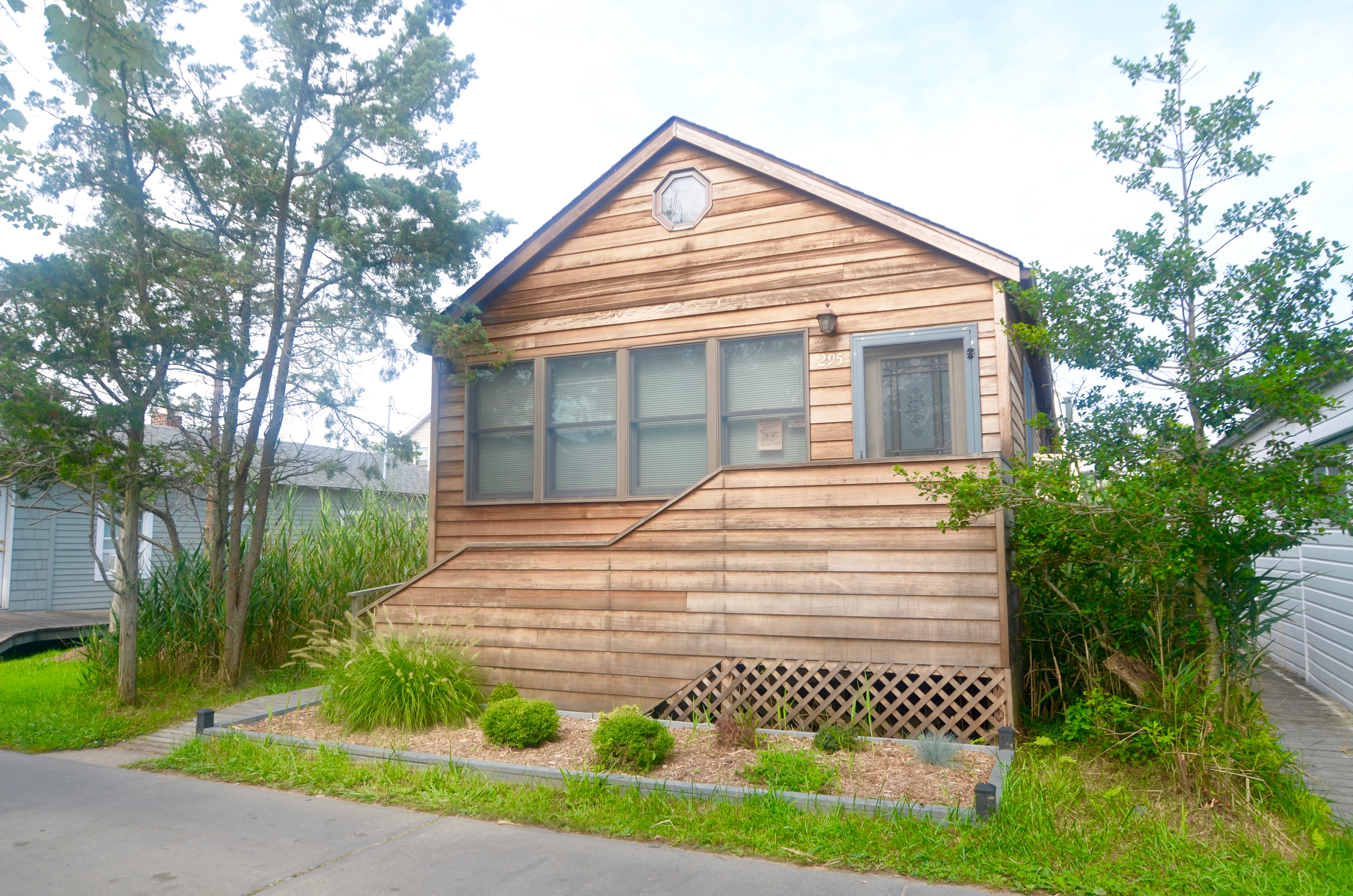 This welcoming cottage is suitable for year round use.  The comfortable living area is open to the kitchen and dining area.  Roof and foundation recently replaced.  Large master bedroom with attached half bath.  Sunny rear deck and outdoor shower.  Great starter home at an excellent price!