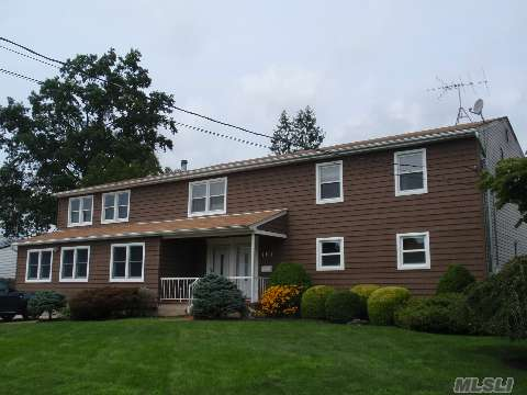 Truly Diamond!! Colossal Colonial With Permit For 3 Bdrm Accessory Apartment. First Floor Has Been Totally Updated W Gleaming Wood Floors, Cherry Kitchen W Granite & Ss Appliances, 2 Story Great Room W Fp, Loft/Office, 2 Designer Baths, Finished Basement W Ext Entry. Private Fenced Yard With Deck. Too Much To List.  Must See To Appreciate The Space And Upgrades.