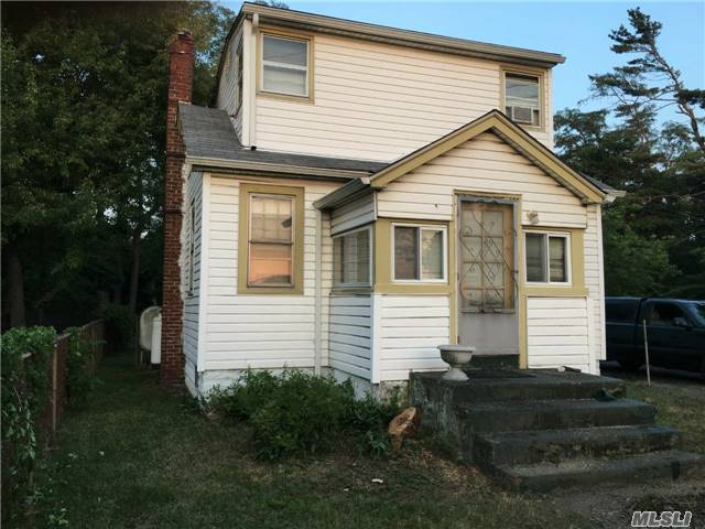 3 Bedroom Cape Nestled On Tranquil .31 Acre Property. Solid Home In Need Of Tlc And Updates. New Boiler, Hot Water Heater, Roof And Gutters. Investors Are Welcomed!