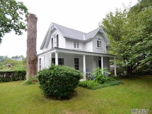 Charming Colonial With Partial Water Views. Entry Foyer, Living Room With Fire Place & Reading Nook Overlooking The Water. Eik, Formal Dining Room, Two Full Baths, Two Large Bedrooms, One Small Bedroom/Nursery/Office. Part Unfinished Basement W/ Outside Entrance.