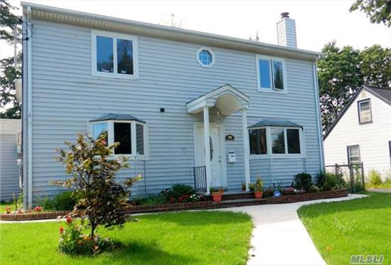 Amazing House! Perfect For Mother-Daughter. Brand New H/W Flooring, Updated Kitchen & 3 Updated Bthrms. 1st Flr Has Offc/Den Space That Could Be 6th Bdrm. Finished Basement, Large Backyard With Deck For Outdoor Entertaining. Great Potential For Large Family. Don't Miss Out, Schedule An Appt Now!