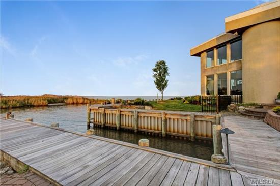 Spectacular Bay Front Home W/4700 Sq Ft Of Living Area. A Secluded Contemporary Estate W/Bay Views From Every Rm. Built In 1985, 5Br, 4.5 Bths, 400Ft Of Bulkhead, Boat Slip, New Custom Kit W/Granite, Viking Stove & Miele Coffee/Espresso System, New Automatic Generator Fueled By Natural Gas, Outdoor Bar W/Sink, Refrig & Icemaker.