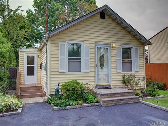 Beautiful 2 Br Ranch In Mint Condition! Great Starter Home With Updated Kitchen, Master Bedroom W/Walk-In Closet And Sliders To Backyard. Finished Basement With Separate Entrance. Park Like Backyard With Brick Patio. A Must See!!