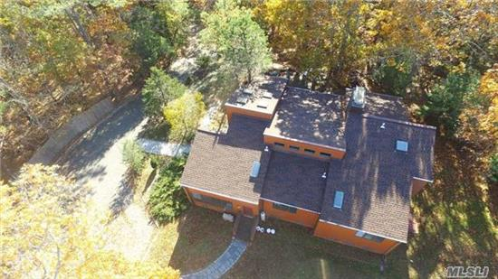 Mini Estate Nestled On 1.60 Secluded Acres. The Open Floor Plan Offers Grand Foyer With Cathedral Ceilings, Eik, Formal Dr, Great Rm W/Wood Burning Stove & Cathedral Ceilings, Master Suite W/Fireplace, 2 Guest Bdrms, 1 1/2 Guest Baths And Partially Finished Basement W/Gym. 2nd Floor Affords 1 Guest Bdrm. Entertain Your Guests On The Expansive Outdoor Patio, Room For Pool.