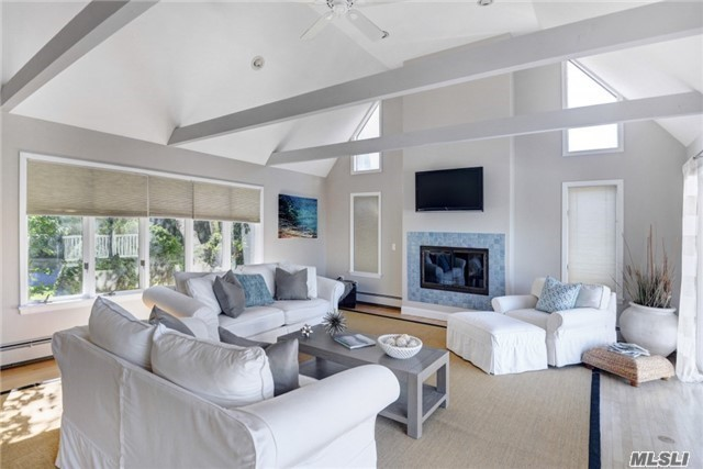 Rising To The Summit Overlooking The Water Sits This Idyllic Home In Private Setting. Light & Bright Living Room Is The Centerpiece Of This Home W/ Soaring Ceilings & Sliding Doors Leading To Expansive Deck W/Waterviews. All Bdrms Boast Waterviews, Including 1st Floor Mstr Suite. Enjoy The Close Proximity To The Beach For Swimming, Fishing Or Just Relaxing! Rm For Pool