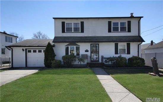 Well Maintained Dormered Cape North Of Hempstead Tpk. Living Room, Eat-In-Kitchen, 2 Bedrooms And Full Bath On First Floor. Two Huge Bedrooms With Walk-In Closets And A Full Jack'n'jill Bathroom Complete With Shower And Bathtub On Second Floor. Full Finished Basement With Utility Room And Laundry Please Note New Price Reduction