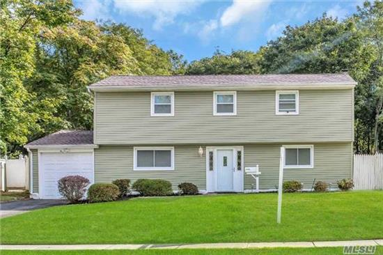 Beautiful & Completely Renovated Split. This Home Sits On An Almost 1/2 Acre Park Like Nestled Property. New Kit W/Gas Cooking, 2 New Baths Refinished Hw Floors Throughout. Finished Bsmt. New Window, Siding And More.Taxes Grieved & Granted $2200 Reduction 17/18!! No Star Have Been Applied. All Is Needed Is You In This Park Like Property!