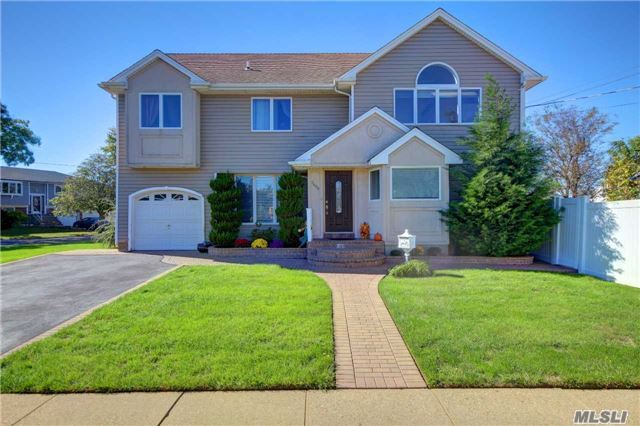 Beautiful Colonial In Wantagh School District. Blue Ribbon Elementary School. Ready To Move In! No Need To Change Anything! Perfect Master Bedroom With A Water View Balcony, And Attached Nursery, Or Gym, Or Office, Your Choice! Corner Property With Amazing Space. Don't Pass This One Up!