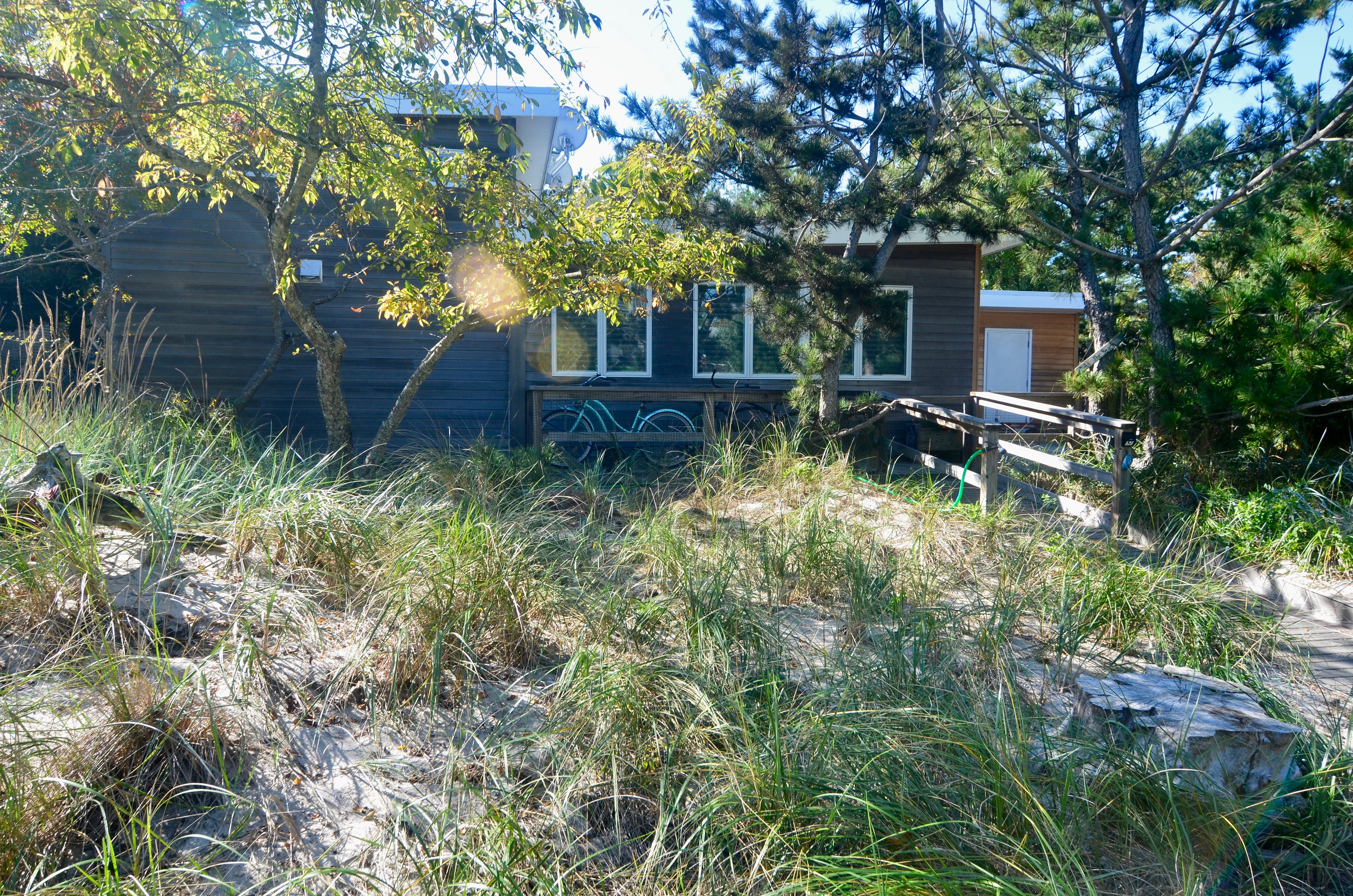 Rarely available home tucked away in a prime location on the east end of Seaview.  Not only is this home only 4 houses back from the beach, but it's situated on a double lot (120' X 100').  The home features 3 bedrooms, 2 bathrooms, and an office.  The beautifully renovated kitchen has high end custom cabinetry, Viking appliances, granite countertops, and opens up to the spacious living and dining areas, which flow nicely out to the large, sunny, west-facing deck.  Enjoy the home as is or expand to create a massive getaway for your family.  Zoning permits a 4,200 SF footprint and a maximum buildable square footage of 8,400 SF.  Concept plans include a second story with deck and a large pool.  This is an amazing opportunity with lots of potential!  This home also has low taxes & carrying charges!