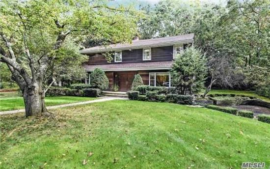 Unique Custom 4 Br Home With Contemp Flair On Quiet Cul-De-Sac In 3 Village. Large Entry Foyer W/Cantilevered Staircase, Front To Back Lr With 2 Huge Windows, Large Formal Dr, Fr W/ Full Wall Fpl, Eik W/Granite Counter, Sitting Area On 2nd Flr. 3 Generous Brs & New Bth, Mbr W/ New Mbth,  Private Back Yard With Stone Wall. Partially Fin. Bsmt W/Lndry & 2 C.Gar. New Roof.