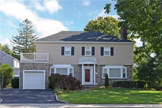Spacious 3 Br, 2.5 Bth Ch Colonial In Sd#20(Lynbrook) In Beautiful Hewlett/East Rockaway Neighborhood. Gran/Wood Eik, Fdr, Lr/Fpl, Den & Enclosed Sun Room, Full Fin Bsmt W/ Playroom, Utilities & Storage. Attached 1 Car Garage. Second Flr Deck Provides Easy Expansion Of 4 Br If Necessary. Great Location Near All. Nice Yard! Low Taxes