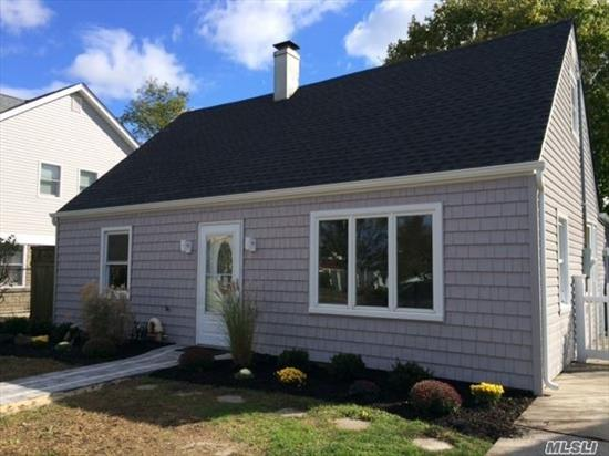 Totally Redone Rear Dormered And Expanded Cape, Featuring Brand New Kitchen, Baths, Roof, Siding, Windows, Skylights, Floors, Doors And Freshly Painted.