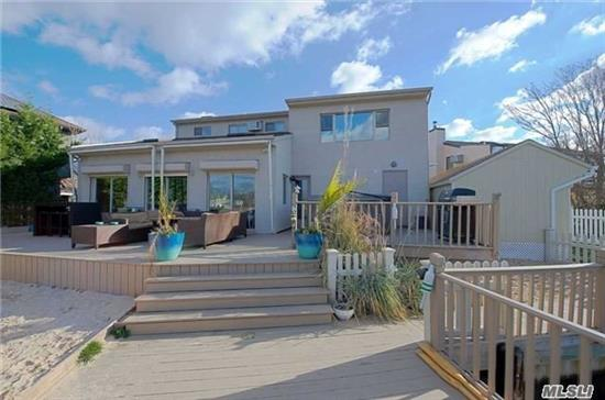 Beautiful Contemporary Home Sitting On Narraskatuck Creek, Only A Few Houses From The Bay With Amazing Views. A True Boater's Dream Home With Wide Canal, 100 Ft. Of Bulkhead & 45X25 Cut In Boat Slip, Great Eik W/Ss App., Large Glass Sliding Doors With Amazing Sunlight. Great Entertaining Backyard W/New Pvc Fence. All New Heating System, And Wood Floors In The Last Few Years!