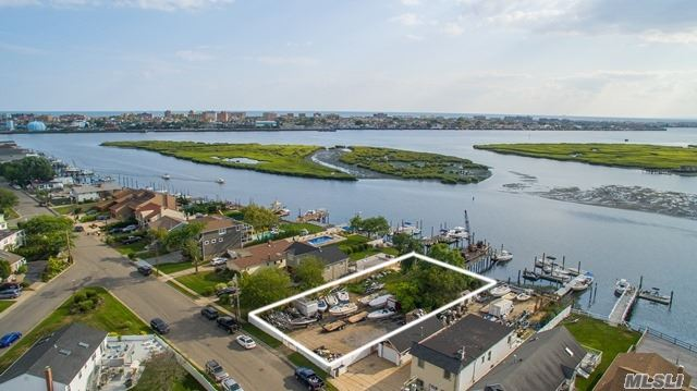 Large Bay Front Vacant Lot 80' X 158' With 90' Of Bulkhead. New Dock With Room For 2 Boats. Rare West Facing Lot On Hog Channel With Sensational Sunsets! Year-Round Waterway, Deep Water Dock. Forever Unobstructed Views Due To Wetlands In Front. Survey Available. Partially Cleared.