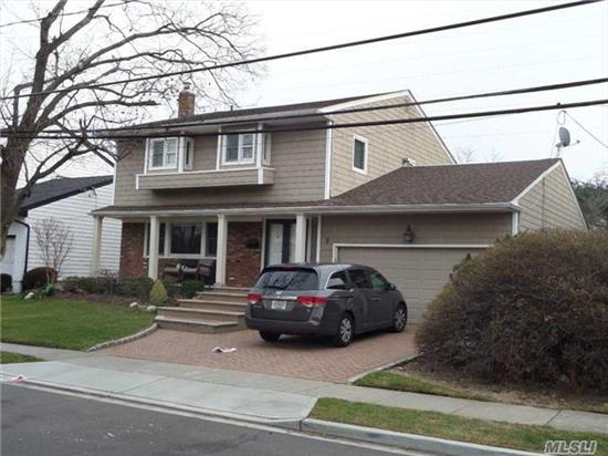 4 Bedroom Colonial 3 Full Baths, Large Den, And Finished Basement In Quiet Tree-Lined Street In Woodmere.