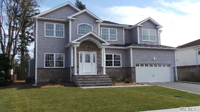 Gorgeous Custom Colonial! Most Prominent Builder..Fully Loaded Home! Designer Kit/Granite/Ge Profile S/S Appli/Center Island..Cust Baths..Cust Molding..Family Room With Gas Frplc..2 Zone Heat/Cac..2 Car Garage/Ee..Igs..Sod/Front/Grade & Seed/Back...Iron Spindles..Stained Flrs...Pictures For Workmanship Only..Time To Customize Your Dream Home Is Now!!