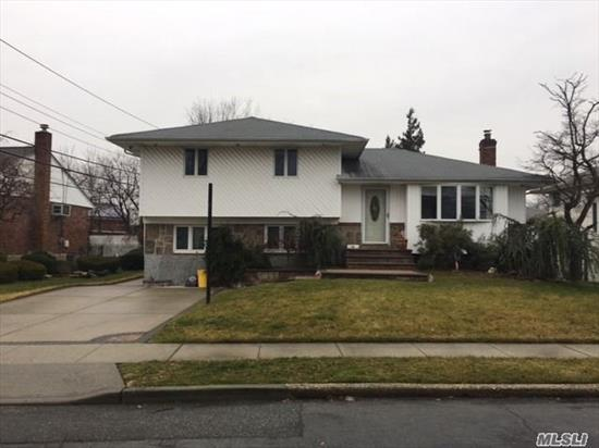 Move Into This Lovely Home & Desirable Neighborhood With Lr, Fdr W/Wood Flrs, Eik W/Island & Sliders To Deck, Upper Level Has Mbr W/Dbl Closet Pull-Down Stairs To Attic, Fbth W/Door To Mbr & Hallway, Br, Br, Lower Level Has Den W/Ose To Backyard, Large Br, Fbth, Part Fin Basement, Utilities, Laundry Area. Plainedge Schools! Mother/Daughter W/Proper Permits.