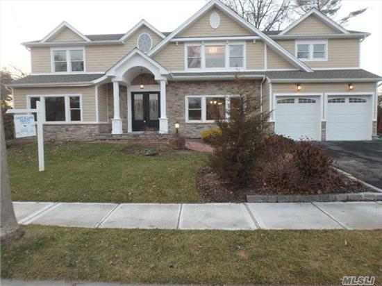 Prepared To Be Wowed. Features Include: 9 Ft Ceilings On First Floor And Basement, Custom Wood Floors And Custom Trim, Wolf And Sub Zero Appliances. Hydronic And Radiant Heating System, Deck Off Master Bdrm, Exterior Is Hardie Board/Stone/Azek Trim, Lg Blue Stone Patio. Too Much To List. This Is A True Must See.