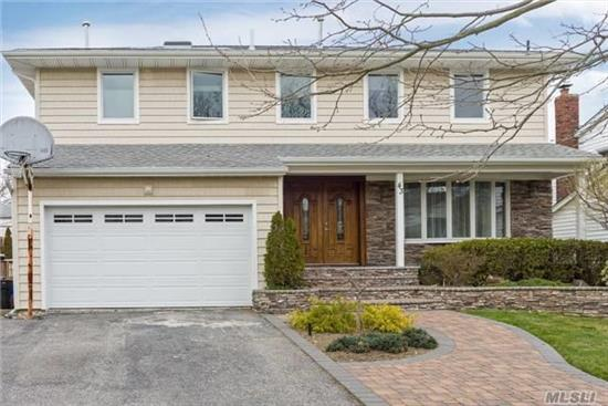Gorgeous And Very Large Fully Redone 5 Bedroom Colonial With 3.5 Baths. Home Has New Electric, Plumbing, Sheetrock And Exterior. Kitchen Features Double Ovens, Double Sinks And Double Dishwashers. Full Height (Unfinished) Basement With French Drains. Must See!