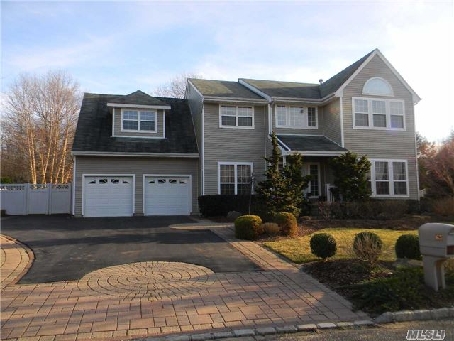 Sprawling Beautifully Landscaped 5 Bedroom Colonial On Private Treed 1/2 Acre, Open Floor Plan Hard Wood Floors Throughout, Finished Basement, Only Five Minutes To Stony Brook University, Three Village School District, Motivated Seller!