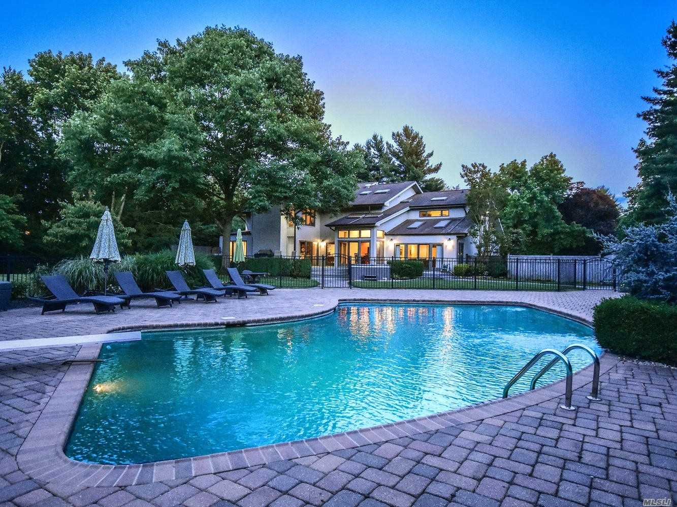 This Home Is Perfectly Located 20 Miles From Nyc And Jfk/Laguardia Airports And Close To The Finest Shopping And Dining On Long Island. Tasteful Finishes Throughout Including Elegant Fabric Wall Coverings And Custom Window Treatments. Entertaining Is Easy In The Generous Size Rooms And Spacious Deck Overlooking The Property And Pool-House Generator.