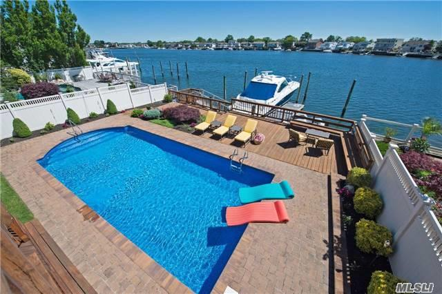 This Gorgeous Hi-Ranch W/ Scenic Water Views Has It All. Resort Setting Backyard W/ Sound System, New Floating Dock W/ Ipe Hardwood Decking, Ramp And Bulkhead, Hot Tub And Outdoor Tv. Deep And Wide Canal. Featuring A Full House Generator, Heated Saltwater Pool W/ New Liner, New Pavers , New Washer/Dryer, French Doors, Refrigerator And So Much More. Low Taxes & Flood Ins.