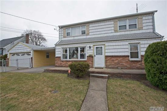 Co's Are Complete - This Exp. Cape Offers Lots Of Space For An Extended Family. Front Door Opens To First Flr Living Space And Stairs To Second Living Space. First Flr Has An Eik, 2Bdrms, Fbath. Second Flr Has 2Bdrms, A Fbath And Large Den/Bedrm, Also A Finished Basement. Separate Garage For Plenty Of Storage And Parking. Easy Conversion With Proper Permits.