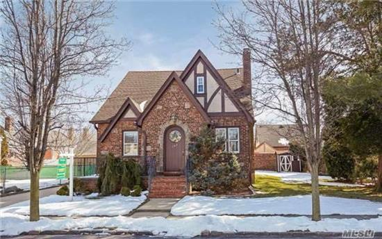 This Charming 1 Family Tudor Home Includes 4 Bedrooms, 2 Full Baths & 2 Half Baths. Living Rm W/ Fireplace, Formal Dining Rm & Eat-In Kitchen. Full Finish Basement W/ Laundry Rm, Workout Rm, Family Rm And Office. 1 Garage And Private Driveway. Great Location - Close To All !!